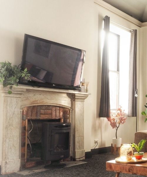 Close up of T.V. and fireplace