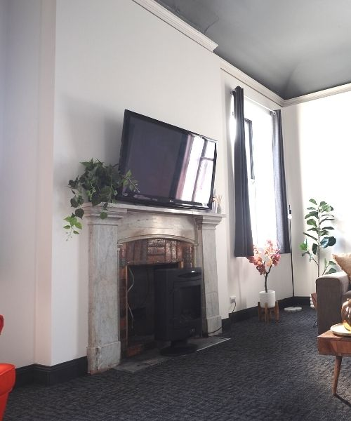 T.V and fireplace in self contained apartment